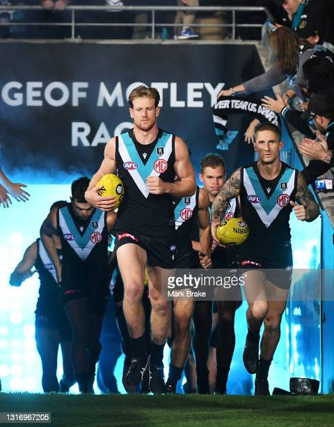 Tom Jonas of Port Adelaide leads his team out during the round eight AFL match between the Port Adelaide Power and the Adelaide Crows at Adelaide...