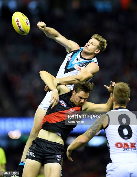 Tom Jonas of Port Adelaide rucks over Joe Daniher of the Bombers during the round four AFL match between the Essendon Bombers and the Port Adelaide...
