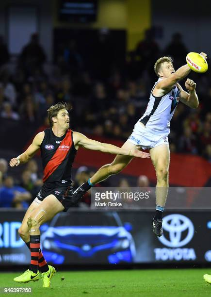 Tom Jonas of Port Adelaide spoils over Joe Daniher of the Bombers during the round four AFL match between the Essendon Bombers and the Port Adelaide...