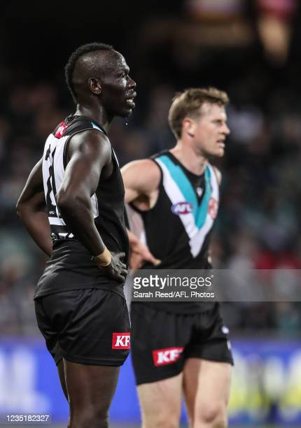 Tom Jonas of the Power and Aliir Aliir put their hands on their hips after another Bulldogs goal goes through during the 2021 AFL Second Preliminary...