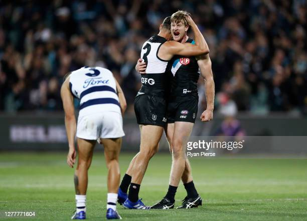 Tom Jonas of the Power and Ryan Burton of the Power celebrate after defeating the Cats during the AFL First Qualifying Final match between the Port...