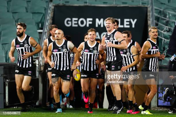 Tom Jonas of the Power leads his team onto the ground during the round 2 AFL match between the Port Adelaide Power and the Adelaide Crows at Adelaide...
