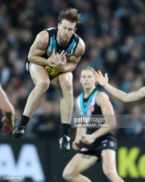 Tom Jonas of the Power marks the ball during the 2021 AFL Round 08 match between the Port Adelaide Power and the Adelaide Crows at Adelaide Oval on...