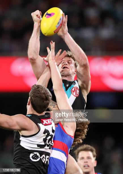 Tom Jonas of the Power punches the ball away during the 2021 AFL Second Preliminary Final match between the Port Adelaide Power and the Western...