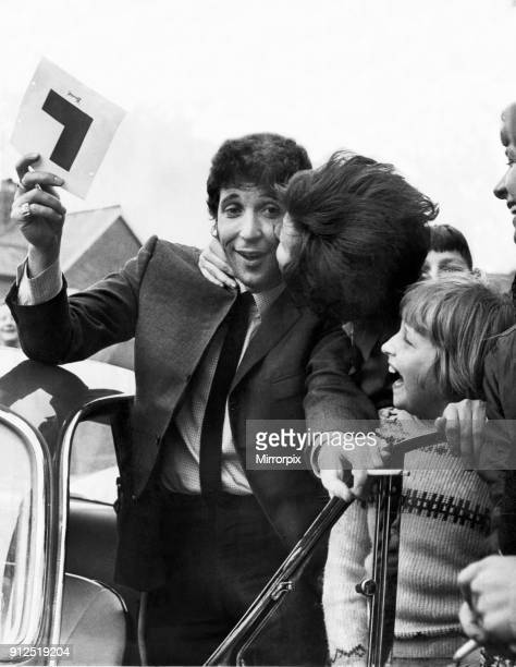 Tom Jones gets a kiss from a fan as he passes his Driving Learners test at Newport Circa 1965