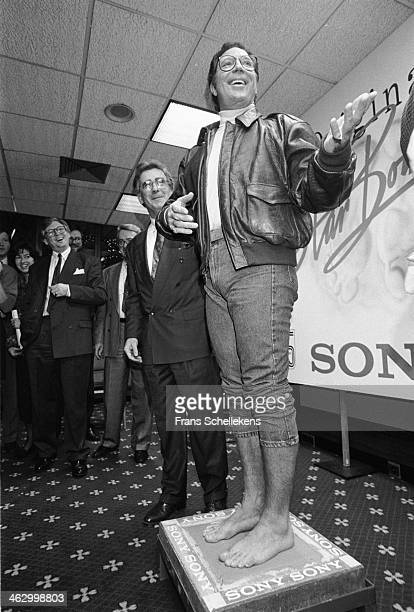 Tom Jones marks his footprints in cement for Sony in the Mariott Hotel on 13th December 1989 in Amsterdam, the Netherlands.