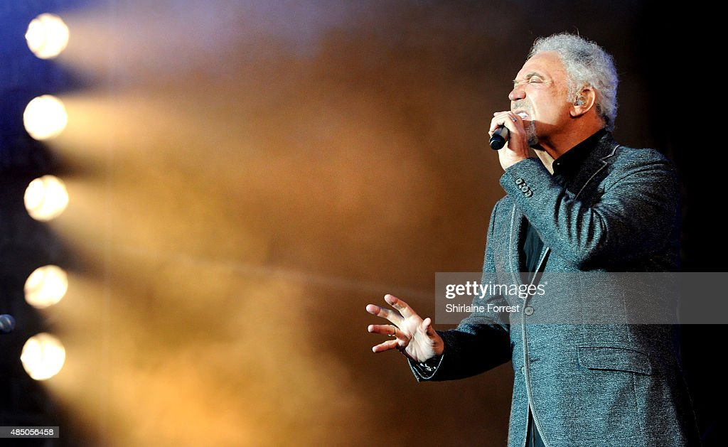 Tom Jones performs on Day 2 of the V Festival at Weston Park on August 23, 2015 in Stafford, England.