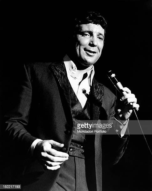 Tom Jones singing with a microphone in his hand London July 1968