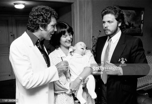 Tom Jones with his grandson Alexander aged eleven months son Mark Woodward and daughterinlaw Donna in their London hotel 3rd September 1983