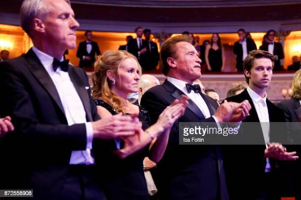 Tom Junkersdorf chief editor GQ magazine Germany Heather Milligan US actor Arnold Schwarzenegger and his son Patrick Schwarzenegger during the GQ Men...