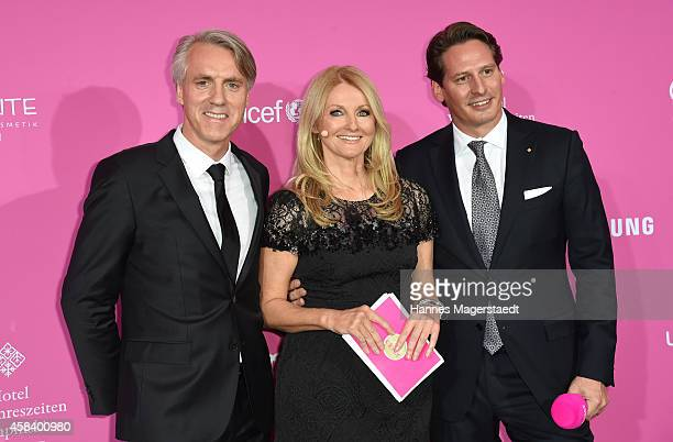 Tom Junkersdorf, Frauke Ludowig and Axel Ludwig attend the 'CLOSER Magazin Hosts SMILE Award 2014' at Hotel Vier Jahreszeiten on November 4, 2014 in...