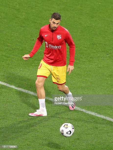 Tom Juric of Adelaide United warms up prior to the A-League match between Melbourne City and Adelaide United at AAMI Park, on May 13 in Melbourne,...