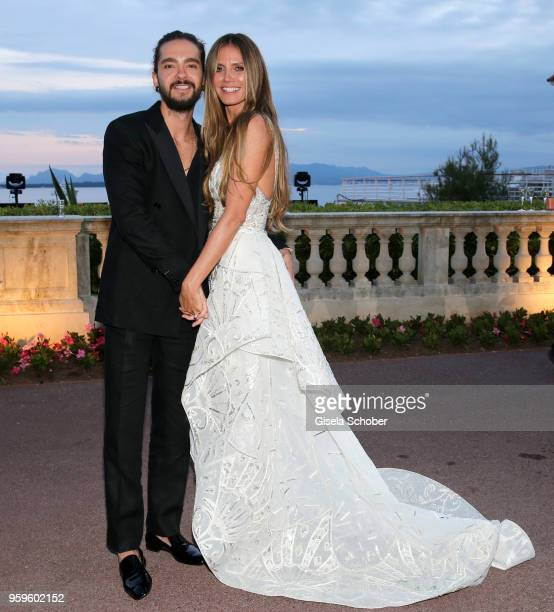 Tom Kaulitz and Heidi Klum attend the amfAR Gala Cannes 2018 dinner at Hotel du Cap-Eden-Roc on May 17, 2018 in Cap d'Antibes, France.