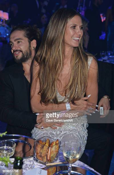 Tom Kaulitz and Heidi Klum attend the amfAR Gala Cannes 2018 dinner at Hotel du CapEdenRoc on May 17 2018 in Cap d'Antibes France