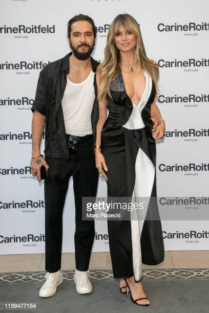 Tom Kaulitz and Heidi Klum attend the Carine Roitfeld Parfums 7 lovers Cocktail At The Peninsula Hotel In Paris on July 01 2019 in Paris France