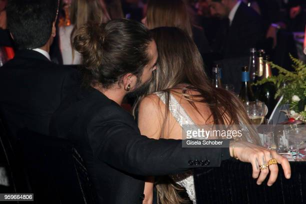 Tom Kaulitz and Heidi Klum cuddle at the amfAR Gala Cannes 2018 at Hotel du CapEdenRoc on May 17 2018 in Cap d'Antibes France