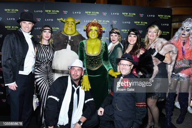 Tom Kaulitz and Heidi Klum pose with guests at Heidi Klum's 19th Annual Halloween Party presented by Party City and SVEDKA Vodka at LAVO New York on...
