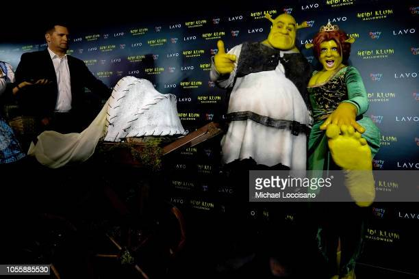 Tom Kaulitz and Heidi Klum show up dressed as Shrek and Princess Fiona to Klum's 19th Annual Halloween Party at Lavo on October 31 2018 in New York...