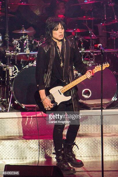 Tom Keifer of Cinderella performs onstage at Alice Cooper's 13th Annual Christmas Pudding Concert at Comerica Theatre on December 7 2013 in Phoenix...