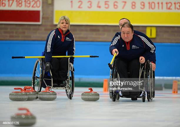 Tom Killin watched by Angela Malone in action during the ParalympicsGB Wheelchair Curling Training Day on 6th January 2014 in Hamilton Scotland