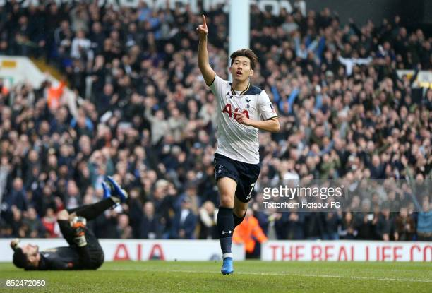 Tom King of Millwall looks dejected as Heung-Min Son of Tottenham Hotspur celebrates as he scores his sides third goal during The Emirates FA Cup...