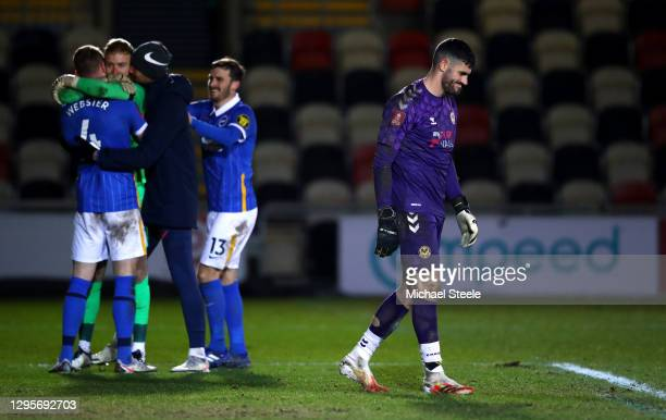Tom King of Newport County reacts as Jason Steele of Brighton and Hove Albion celebrates with teammates Adam Webster and Pascal Gross in the...