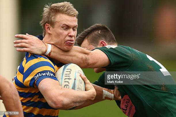 Tom Kingston of Sydney University is tackled during the round nine Shute Shield match between Sydney University and Randwick at University Oval No. 1...