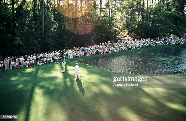 Tom Kite skips the traditional ball across the 16th hole's pond at a practice round during the 1979 Masters Tournament at Augusta National Golf Club...