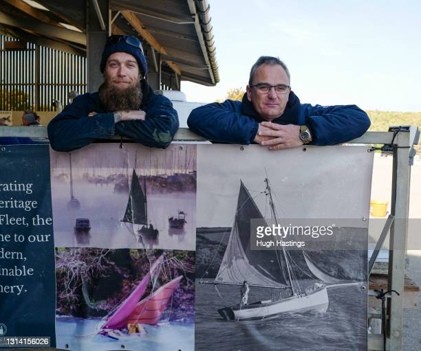 Tom Knights, and Martin Laity co-owners of Cornwall shellfish merchants Sailors Creek, on their stall at the Food Barn on April 24, 2021 in Flushing,...