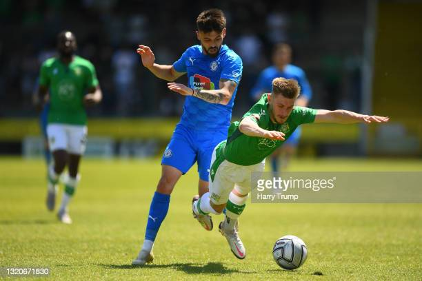 Tom Knowles of Yeovil Town battles for possession with Macauley Southam-Hales of Stockport County during the Vanarama National League match between...
