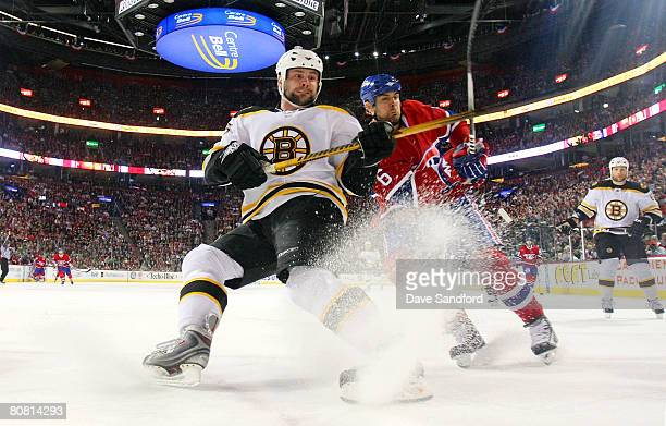 Tom Kostopoulos of the Montreal Canadiens and Mark Stuart of the Boston Bruins battle for position during Game Seven of the 2008 NHL Eastern...