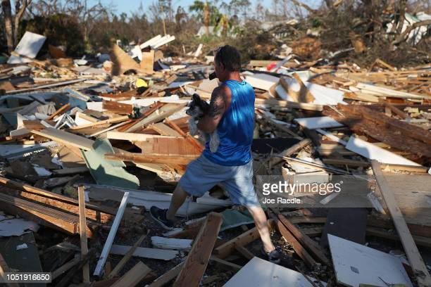 Tom Koziol walks through the debris left in a street next to his home after Hurricane Michael passed through the area on October 11 2018 in Mexico...