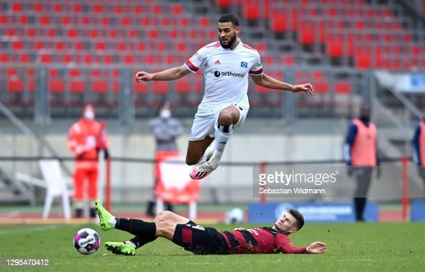 Tom Krauss of 1.FC Nurnberg tackles Josha Vagnoman of Hamburger SV during the Second Bundesliga match between 1. FC Nürnberg and Hamburger SV at...