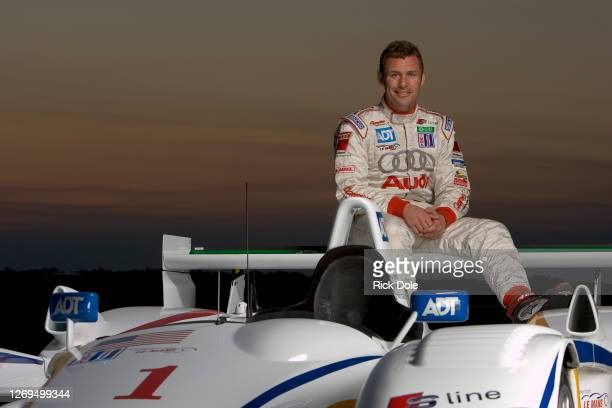 Tom Kristensen of Denmark, 9-time winner of the Le Mans 24 Hours poses for a portrait with the Champion Racing Audi R8 prototype at Sebring...