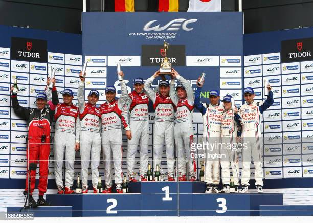 Tom Kristensen of Denmark Allan McNish of Great Britain and Loic Duval of France drivers of the Audi Sport Team Joest Audi R18 etron quattro Hybrid...
