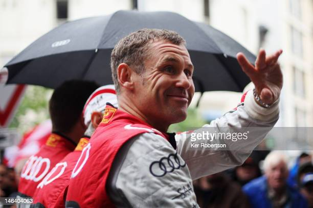Tom Kristensen of Denmark and Audi Sport ETron Quattro attends the drivers parade during previews for the Le Mans 24 Hour race on June 15 2012 in Le...