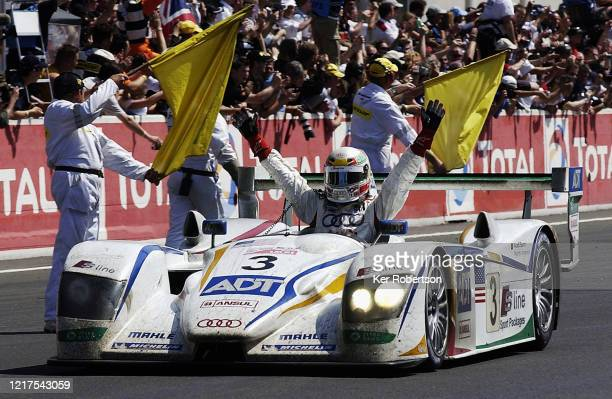 Tom Kristensen of Denmark and Champion Racing Audi R8 team celebrates winning the Le Mans 24 Hour Race along with JJ Lehto and Marco Werner at the...