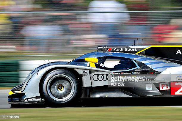 Tom Kristensen of Denmark drives the Audi Sport Team Joest Audi R18 during the American Le Mans Series Petit Le Mans Powered by Mazda at Road Atlanta...