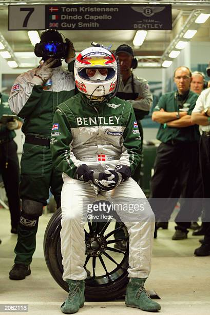 Tom Kristensen of the Holland and Bentley awaits his driver change during the Le Mans 24 Hours race on June 14 2003 at The Circuit de la Sarthe Le...