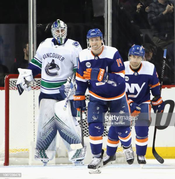 Tom Kuhnhackl of the New York Islanders skates back to the bench after scoring his second goal of the game at 326 of the third period against Jacob...
