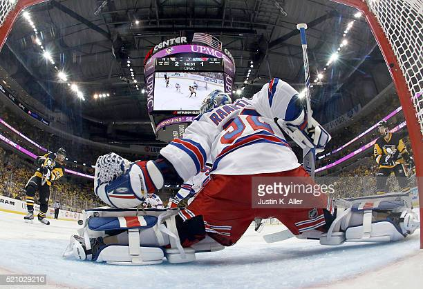 Tom Kuhnhackl of the Pittsburgh Penguins scores past Antti Raanta of the New York Rangers in Game One of the Eastern Conference Quarterfinals during...