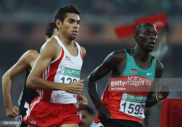 Tom Lancashire of England and James Magut of Kenya compete in the men's 1500 metres first round at Jawaharlal Nehru Stadium during day eight of the...
