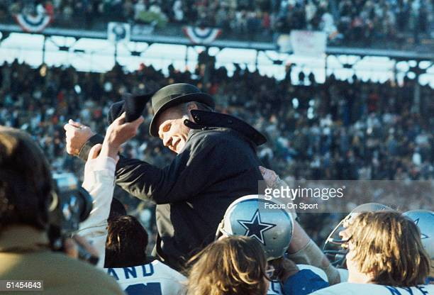 Tom Landry head coach of the Dallas Cowboys is carried off the field by his team after winning Super Bowl VI against the Miami Dolphins at Tulane...