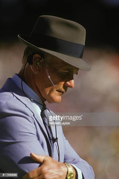 Tom Landry head coach of the Dallas Cowboys looks on during an NFL football game against the Washington Reskins on November 1 1989 atRFK Stadium in...