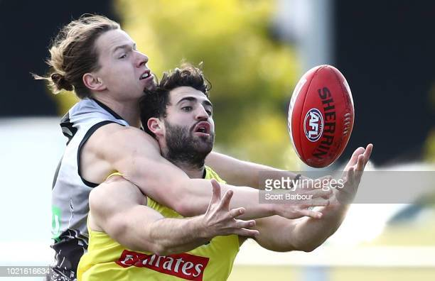 Tom Langdon of the Magpies and Alex Fasolo of the Magpies compete for the ball during a Collingwood Magpies AFL training session at the Holden Centre...