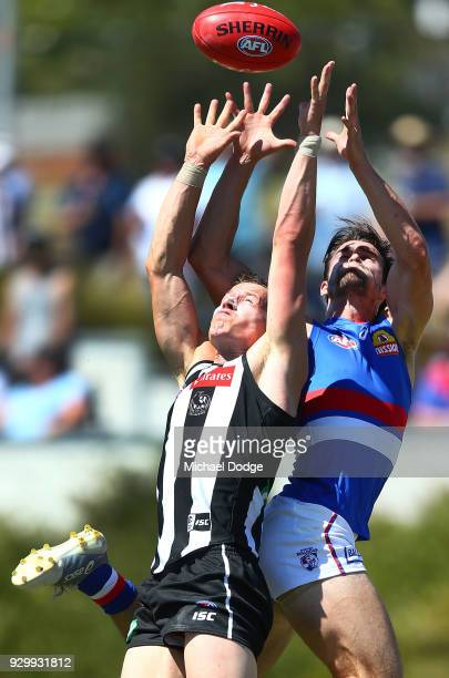 Tom Langdon of the Magpies and Easton Wood of the Bulldogs compete for the ball during the JLT Community Series AFL match between Collingwood Magpies...
