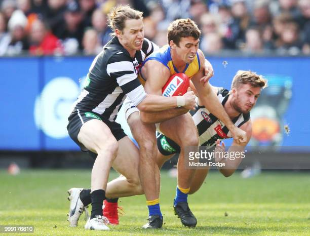 Tom Langdon of the Magpies and Sam Murray tackles Jamie Cripps of the Eagles during the round 17 AFL match between the Collingwood Magpies and the...