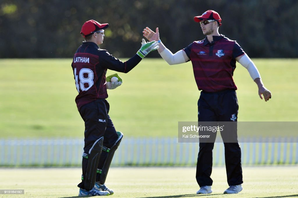 Tom Latham of Canterbury is congratulated by Cameron Fletcher of Canterbury (L-R) after taking a catch to dismiss Lockie Ferguson of the Auckland Aces during the One Day Ford Trophy Cup match between Canterbury and Auckland on February 7, 2018 in Christchurch, New Zealand.