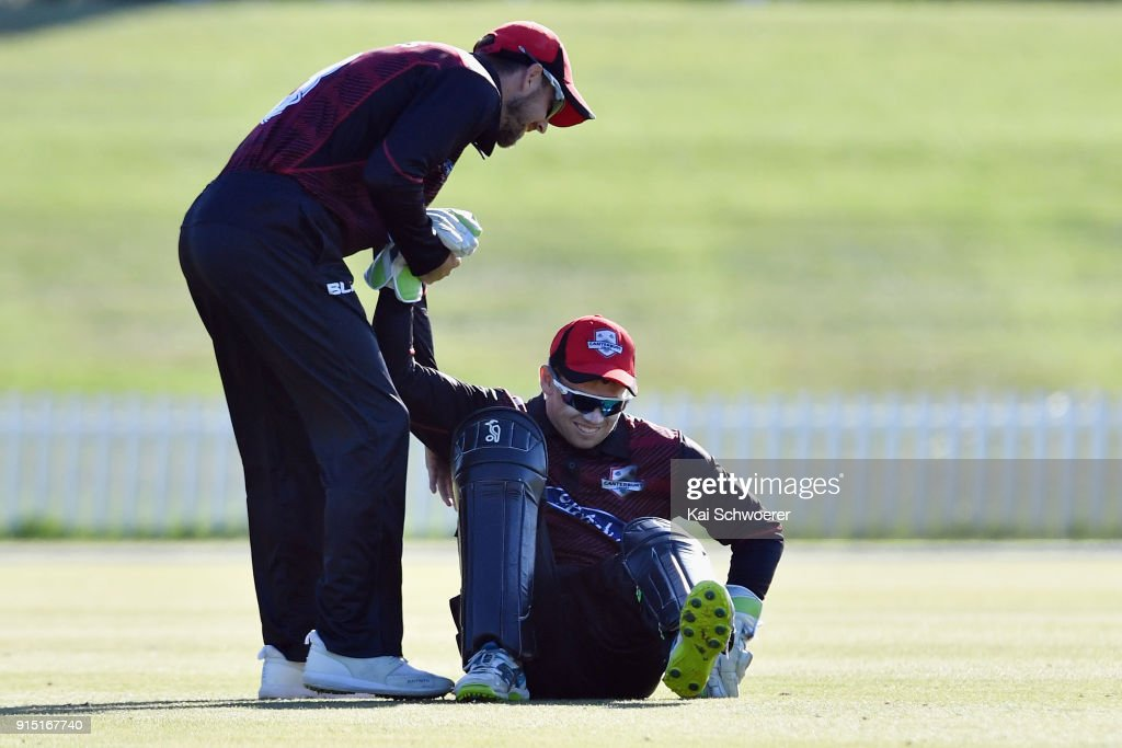 Tom Latham of Canterbury (R) is congratulated by team mates after taking a catch to dismiss Lockie Ferguson of the Auckland Aces during the One Day Ford Trophy Cup match between Canterbury and Auckland on February 7, 2018 in Christchurch, New Zealand.