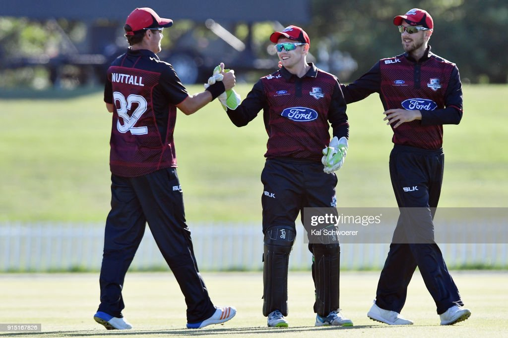Tom Latham of Canterbury (C) is congratulated by team mates after taking a catch to dismiss Lockie Ferguson of the Auckland Aces during the One Day Ford Trophy Cup match between Canterbury and Auckland on February 7, 2018 in Christchurch, New Zealand.